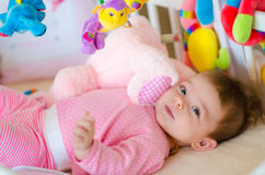 Baby in a cot Stock Photography