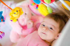 Baby in a cot Stock Photos