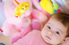 Baby in a cot Stock Images