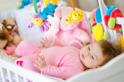 Baby in a cot Royalty Free Stock Photography