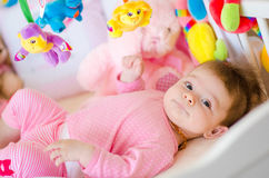 Baby in a cot Royalty Free Stock Photos