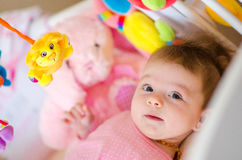 Baby in a cot Royalty Free Stock Photo