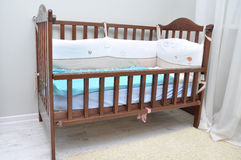 Baby cot made of wood in the room Royalty Free Stock Images
