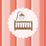 Baby cot with toy. Striped background Royalty Free Stock Image
