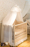 Baby cot. Wooden baby cot with curtain Royalty Free Stock Photos