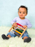 Baby counting with abacus Royalty Free Stock Images