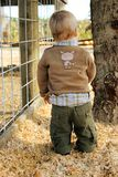 Baby in the country. Stylish baby boy is dressed in fall outfit at the farm or in rural setting royalty free stock photography