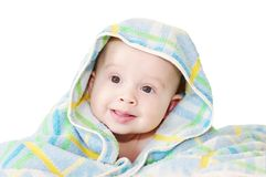 Baby covered by a blue blanket on a white background Royalty Free Stock Photo