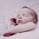 Baby Covered in Pink. Sleeping baby covered in pink Royalty Free Stock Image