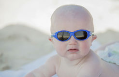 A baby is covered with sunscreen at the beach in Mexico Royalty Free Stock Photo