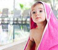 Baby covered with towel Stock Photo