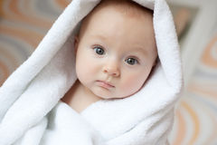 Baby covered with white towel Stock Image