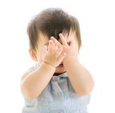 Baby covering eye. Isolated on white royalty free stock photo