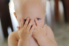 Baby Covering Face with her hands Royalty Free Stock Photos