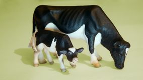With a baby cow. Statuette with a baby cow Stock Photos