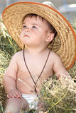 Baby cowboy in the hay Stock Images