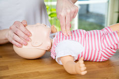 Baby CPR one hand compression Royalty Free Stock Image