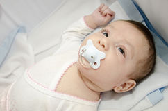 Baby in cradle Stock Image