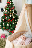 The baby is in the cradle. Christmas Royalty Free Stock Image