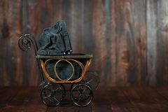 Baby Cradle on Grunge Wooden Background Royalty Free Stock Photography