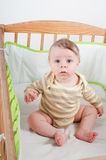 Baby in cradle. Baby in striprd clothes sitting in cradle stock images