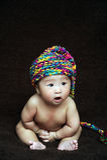 Baby in cradle Stock Photos