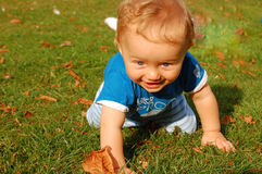 Baby crawling. Baby boy crawling on green grass stock images