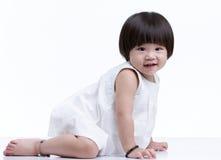 Baby crawling. Cute baby girl crawling, isolated on white background stock image