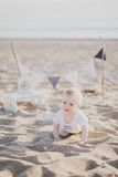 Baby crawling on the beach. Baby crawlingon the sand on the beach Stock Image