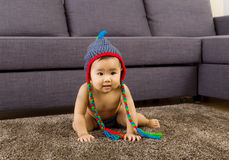 Baby crawling on carpet Royalty Free Stock Images