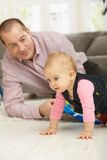 Baby crawling on floor Royalty Free Stock Images
