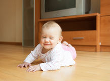 Baby crawling on the floor Royalty Free Stock Photography