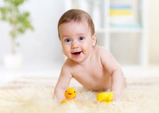 Baby crawling on fluffy carpet at home stock image