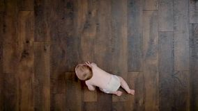 Baby crawling high angle view