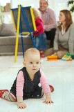 Baby crawling in living room Royalty Free Stock Photography