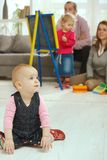 Baby crawling in living room Stock Images