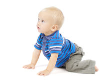 Baby crawling looking up over white. Active one year baby crawling over white background stock photo