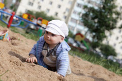 Baby crawling in sandbox Royalty Free Stock Photo