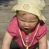 Baby crawling and shouting. Young baby girl crawling and shouting Royalty Free Stock Photo