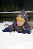 Baby crawling in snow Royalty Free Stock Photography