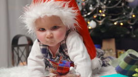 Baby crawling towards Christmas gifts stock footage
