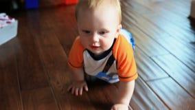 Baby Crawling. V2. Tracking shot of baby crawling towards camera stock video footage