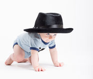 Baby Crawling Wearing a Black Fedora Royalty Free Stock Photography