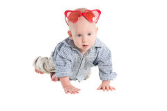 Baby crawls on all fours and look Royalty Free Stock Images