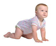 Baby crawls on all fours and look up Stock Image