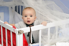Baby in a crib. Baby boy standing up in his crib Stock Image