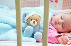 Baby in crib. Little girl in a crib royalty free stock photos