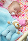 Baby in crib. Little girl in a crib royalty free stock image