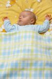 Baby in crib. Little girl in a crib stock image