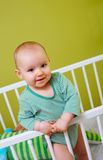 Baby in crib. Portrait of little baby in crib Royalty Free Stock Photos